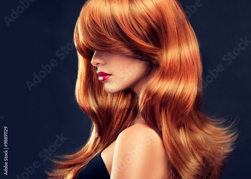 Beautiful model girl  with long red curly hair  Plakat