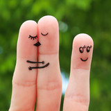 Finger art of a Happy couple. The happy couple kissing and hugging. The other girl looks at them and rejoices.