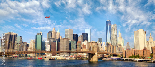 Manhattan skyline panorama with Brooklyn Bridge in New York City, United States