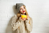 Fototapety Romantic Dreaming Winter Hipster Girl with a Mug
