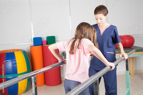 Physical therapist with patient in rehabilitation