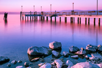 Surreal pink sunset long exposure, Bracciano Lake at Anguillara Sabazia, Lazio, Italy. © eZeePics Studio