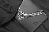 Graduation Day. Graduate gown, diploma and tassel in black and white.