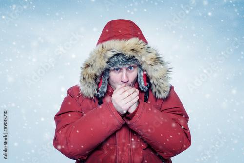 Man in winter clothes warming hands, cold, snow, blizzard Plakát