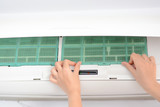 Replacing air conditioning filters to clean dust and prevent bacteria