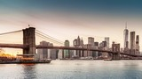 Timelapse with Brooklyn Bridge and Lower Manhattan going through sunset, dusk and night