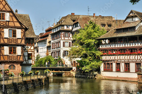 Plagát old houses in the district of La Petite France in Strasbourg