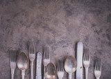 Vintage silverware from bottom side of grunge background