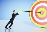 Move towards your goal concept with businessman pushing an arrow