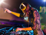 Fototapety Beautiful DJ girl mixing electronic music