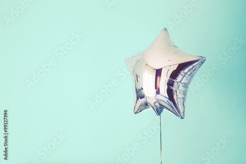 star balloon of success on colorful background