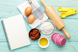 Baking background with blank notebook