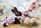 Fototapety Easter background, card with easter eggs, chocolate bunny and pink spring blossoms