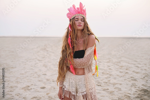 Beautiful bohemian gypsy girl with long hair on the sunset beach - 99415595