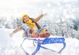 Child girl sledding