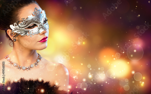 Fototapeta Elegance Woman Wearing Carnival Mask With Golden Stardust