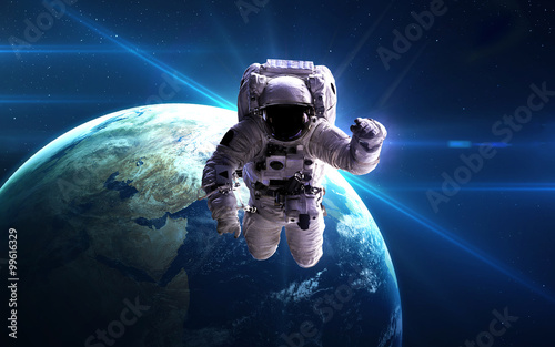 Astronaut in outer space against the backdrop of the planet. Elements of this image furnished by NASA.