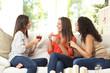 Three friends talking at home