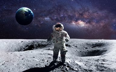 Brave astronaut at the spacewalk on the moon. This image elements furnished by NASA.