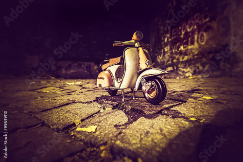 Aluminium Scooter Old Vespa in dark alley