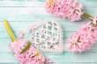 Obrazy na płótnie, fototapety, zdjęcia, fotoobrazy drukowane : Decorative heart  and flowers on wooden background