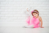 Fototapety little girl dancer ballet ballerina stretching