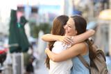 Fototapety Happy meeting of friends hugging