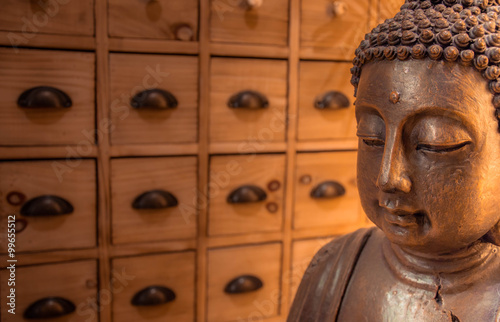 buddha kopf vor asiatischen apothekerschrank stock photo. Black Bedroom Furniture Sets. Home Design Ideas