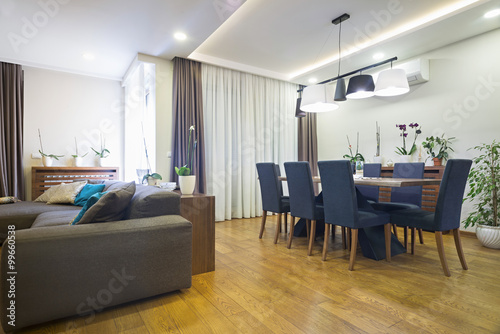 Dining room interior in modern apartment Poster