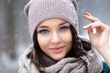 Beautiful young woman in wintertime outdoor