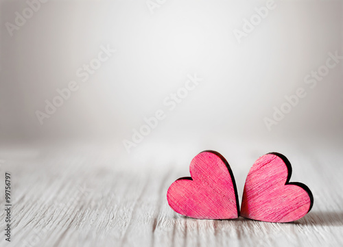 Zdjęcia na płótnie, fototapety, obrazy : Valentines day background with two red hearts on wooden background