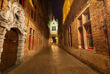 Fototapety Nigth view of Blinde Ezelstrat., popular alley in Bruges, Belgium