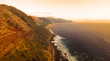 Sunset aerial view of beautiful Kaena coast on the north west of Oahu, Hawaii at sunset.