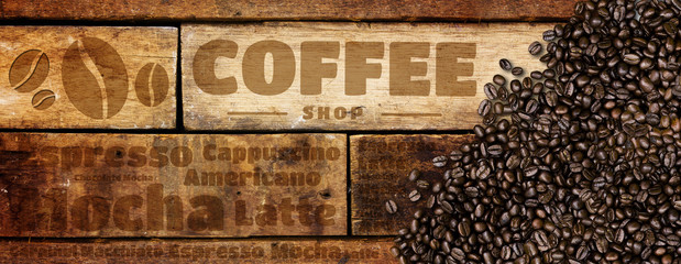 Coffee beans on wood background © memorystockphoto