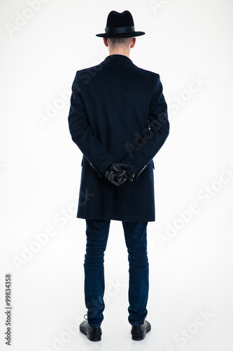 Back view of business man in black clothes and hat Poster
