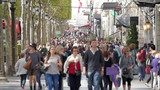 Slow motion of crowded street people walking