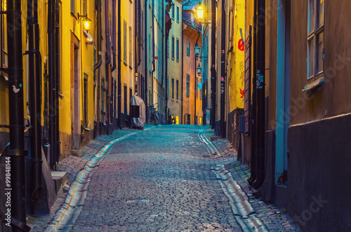 obraz PCV The narrow street of Gamla Stan - historic city old center of Stockholm, at summer night, with lanterns