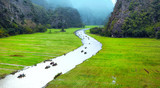 Vietnam travel landscape. Twisted river and mountains of Tam Coc Ninh Binh  - 99871939