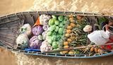 Boat with vegetables in Vietnam floating market  - 99874367
