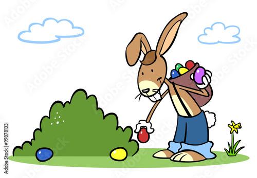 Fototapeta Cartoon Osterhase beim Ostereier verstecken