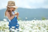 Happy little girl in a camomile field  - Fine Art prints