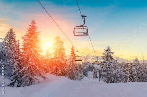 Leinwandbild Motiv Sunset in winter landscape  in mountains Julian Alps
