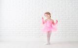 Fototapety little child girl dreams of becoming  ballerina