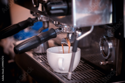 preparing coffee in cafe