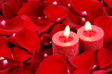 red candles and rose petals background
