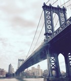 Manhattan bridge over the river in vintage style, New York