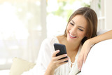 Girl reading message in a smart phone