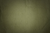fragment of dense synthetic fabric olive backgtound