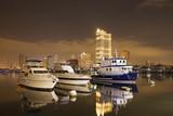 Катера в пирсе Манилы на закате