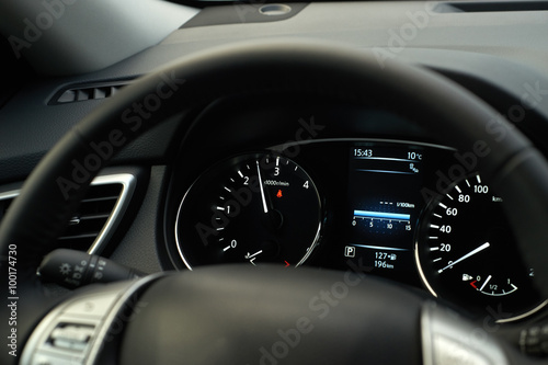 Poster Modern car speedometer and illuminated dashboard